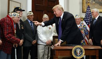 President Donald Trump points at Lawrence Parry as he arrive for an event with Pearl Harbor survivors in the Roosevelt Room of the White House, Thursday, Dec. 7, 2017, in Washington. (AP Photo/Evan Vucci)