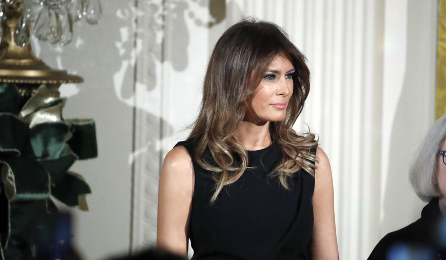 First lady Melania Trump stands while her husband President Donald Trump speaks during a Hanukkah reception in the East Room of the White House, Thursday, Dec. 7, 2017, in Washington. (AP Photo/Alex Brandon)