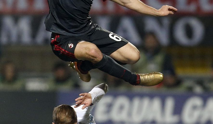 Milan's Patrick Cutrone, top, jumps over Rijeka's Dario Zuparic during the group D Europa League soccer match between Rijeka and Milan, at the Rujevica stadium in Rijeka, Croatia, Thursday, Dec. 7, 2017. (AP Photo/Darko Bandic)