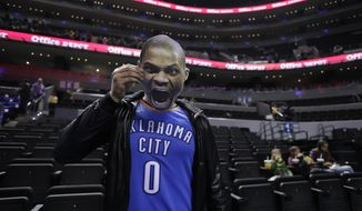 Basketball fan David Martinez, of Monterrey, poses with a cardboard cutout of Oklahoma City Thunder's player Russell Westbrook before a regular-season NBA basketball game against the Brooklyn Nets in Mexico City, Thursday, Dec. 7, 2017. The Brooklyn Nets will also take on the Miami Heat Saturday in their second regular-season game in the Mexican capital. (AP Photo/Rebecca Blackwell)
