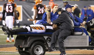 In this Monday, Dec. 4, 2017 file photo, Cincinnati Bengals outside linebacker Vontaze Burfict gestures as he is carted off the field after an apparent injury in the second half of an NFL football game against the Pittsburgh Steelers in Cincinnati. Three cornerbacks hurt, a linebacker and a running back in concussion protocol. The Bengals are paying the price for their acerbic, season-dooming loss to the Steelers on Monday night at Paul Brown Stadium. The Bengals play the Chicago Bears on Sunday, Dec. 10, 2017. (AP Photo/Frank Victores, File)