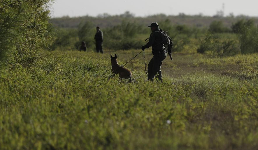In this Aug. 11, 2017, photo U.S. Customs and Border Patrol agents pursue a group of immigrants who are suspected of crossing into the United States illegally, along the Rio Grande near Granjeno, Texas. The election of President Donald Trump contributed to a dramatic downturn in migration, causing the number of arrests at the border to hit an all-time low in April and helping the U.S. end the 2017 fiscal year at a 45-year low. But since bottoming out in April, the number of immigrants caught at the southern border has been increasing monthly. (AP Photo/Eric Gay)