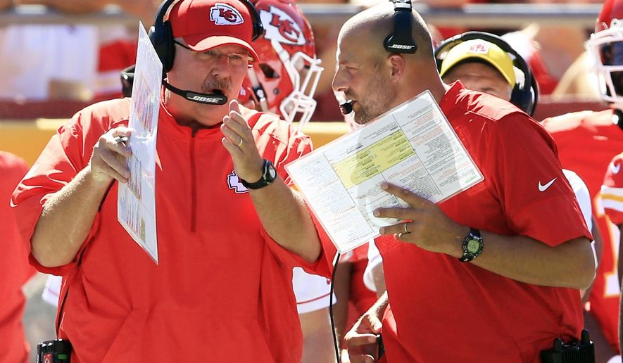 FILE - In this Aug. 13, 2016, file photo, Kansas City Chiefs head coach Andy Reid, left, and co-offensive coordinator Matt Nagy, right, talk during the first half of an NFL preseason football game against the Seattle Seahawks in Kansas City, Mo. Reid turned over some of the playcalling duties to offensive coordinator Matt Nagy last week, and the immediate returns were good. But that wasn't enough for Reid to guarantee Nagy another shot this weekend. (AP Photo/Orlin Wagner, File)