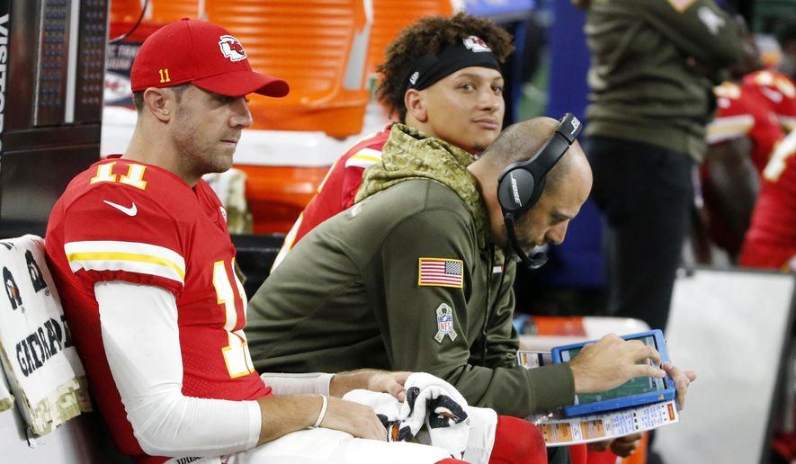 In this Nov. 5, 2017, file photo, Kansas City Chiefs' Alex Smith, left, offensive coordinator Matt Nagy, center and quarterback Patrick Mahomes, rear, sit on the bench during an NFL football game against the Dallas Cowboys in Arlington, Texas. (AP Photo/Michael Ainsworth, File)