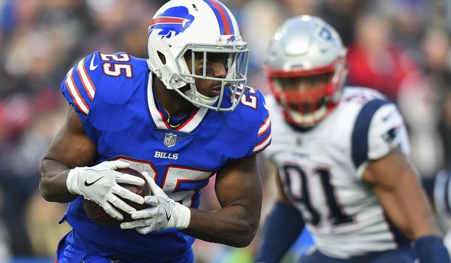 FILE - In this Dec. 3, 2017, file photo, Buffalo Bills running back LeSean McCoy (25) runs with the ball against the New England Patriots during the second half of an NFL football game in Orchard Park, N.Y. McCoy thinks so highly of Frank Gore, he is prepared to give the Indianapolis Colts veteran the jersey off his back after the Bills host Indianapolis on Sunday, Dec. 10, 2017. (AP Photo/Rich Barnes, File)