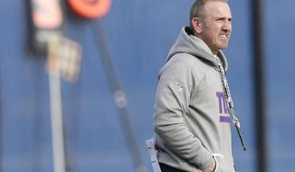 FILE - In this Wednesday, Dec. 6, 2017, file photo, New York Giants interim head coach Steve Spagnuolo watches during NFL football practice in East Rutherford, N.J.  The Giants host the Dallas Cowboys on Sunday. (AP Photo/Seth Wenig, File)