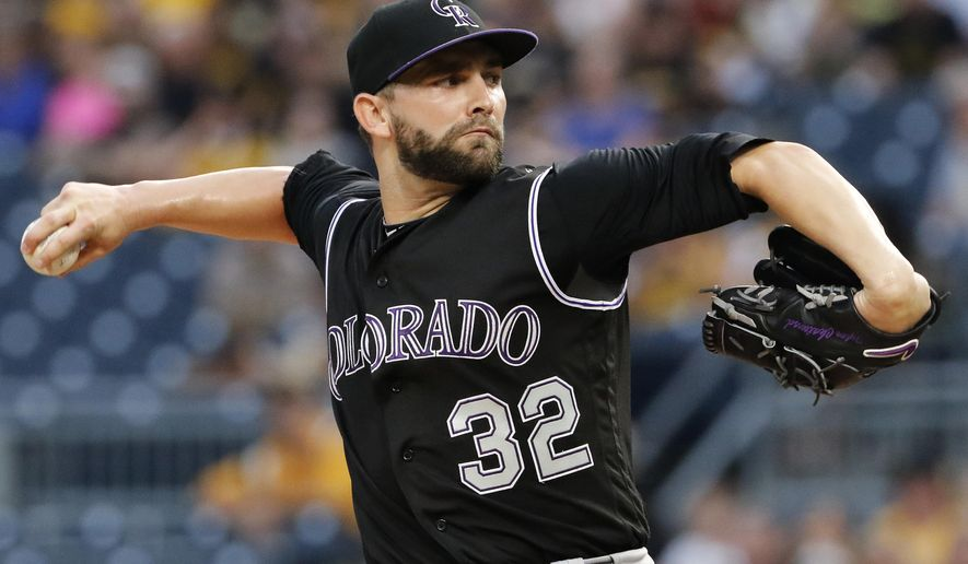 FILE - In this June 13, 2017, file phtoo, Colorado Rockies starting pitcher Tyler Chatwood delivers in the first inning of a baseball game against the Pittsburgh Penghins in Pittsburgh. Chatwood and the Chicago Cubs agreed Thursday, Dec. 7, 2017, to a $38 million, three-year contract. He gets $12.5 million in each of the next two seasons and $13 million in 2020. His 2020 salary would rise to $15 million if he is an All-Star in the previous two seasons and $17 million if he gets Cy Young consideration in the prior two years. (AP Photo/Gene J. Puskar)