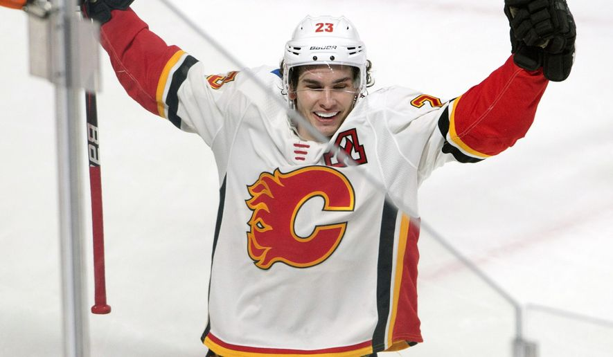 Calgary Flames center Sean Monahan (23) celebrates after scoring the winning goal against the Montreal Canadiens during overtime NHL hockey game action Thursday, Dec. 7, 2017, in Montreal. (Ryan Remiorz/The Canadian Press via AP)