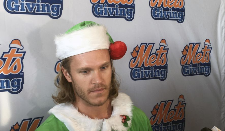 New York Mets baseball player Noah Syndergaard speaks to the the media during the Mets annual Kids Holiday Party at Citi Fielk in New York, Thursday, Dec. 7, 2017. (AP Photo/Ron Blum)