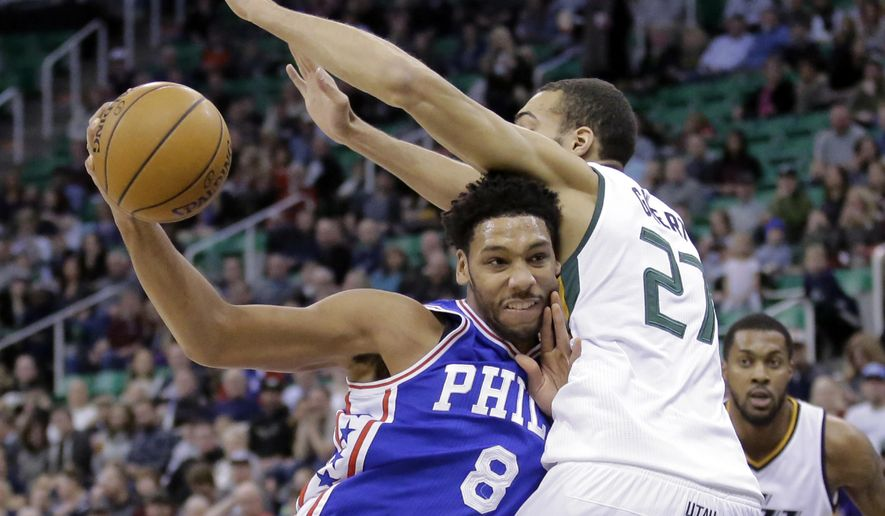 FILE - In this Dec. 29, 2016, file photo, Philadelphia 76ers center Jahlil Okafor (8) drives to the basket as Utah Jazz center Rudy Gobert (27) defends in the first half during an NBA basketball game in Salt Lake City. A person familiar with the deal says 76ers are set to trade beleaguered center Okafor to the Brooklyn Nets. (AP Photo/Rick Bowmer, File) **FILE**