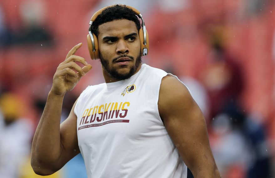 FILE - In this Oct. 29, 2017, file photo, Washington Redskins tight end Jordan Reed reaches for his headphones during warm ups before an NFL football game against the Dallas Cowboys in Landover, Md. Reed is going through the most difficult time of his life as he endures another injury-plagued season. Arguably the Redskins' most effective playmaker, Reed is in danger of missing his sixth consecutive game with a strained hamstring. (AP Photo/Mark Tenally) ** FILE **