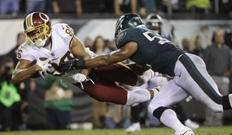 FILE - In this Oct. 23, 2017, file photo, Washington Redskins tight end Jordan Reed (86) dives in for a touchdown as Philadelphia Eagles linebacker Najee Goode (52) tries to stop him during the second half of an NFL football game in Philadelphia. Reed is going through the most difficult time of his life as he endures another injury-plagued season. Arguably the Redskins' most effective playmaker, Reed is in danger of missing his sixth consecutive game with a strained hamstring. (AP Photo/Matt Rourke, File) **FILE**