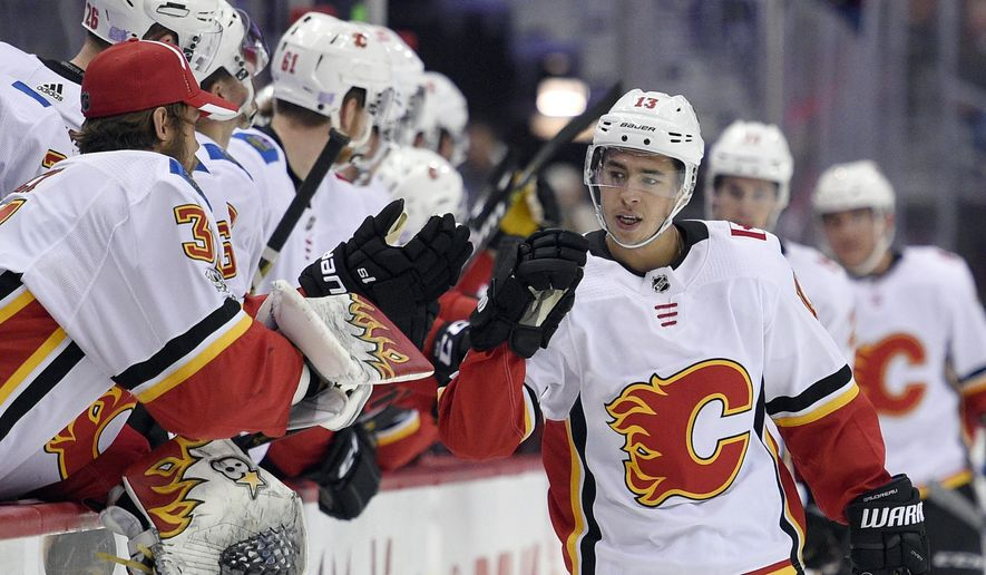 FILE - In this Nov. 20, 2017, file photo ,Calgary Flames left wing Johnny Gaudreau (13) celebrates his goal during the first period of an NHL hockey game against the Washington Capitals in Washington. Through the first two months of the season, goals are up more than 12 percent from the same time a year ago, including a 14 percent increase on the power play and a 38 percent spike short-handed.  (AP Photo/Nick Wass, File)