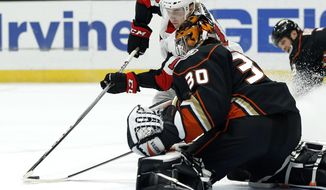 Anaheim Ducks goalie Ryan Miller (30) stops a shot by Ottawa Senators left wing Ryan Dzingel (18) during the first period of an NHL hockey game in Anaheim, Calif., Wednesday, Dec. 6, 2017. (AP Photo/Alex Gallardo)