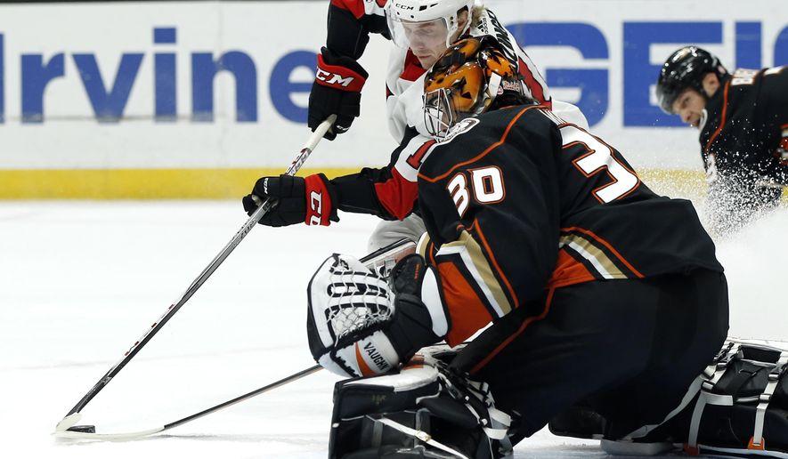Anaheim Ducks goalie Ryan Miller (30) stops a shot by Ottawa Senators left wing Ryan Dzingel (18) during the first period of an NHL hockey game in Anaheim, Calif., Wednesday, Dec. 6, 2017. (AP Photo/Alex Gallardo)