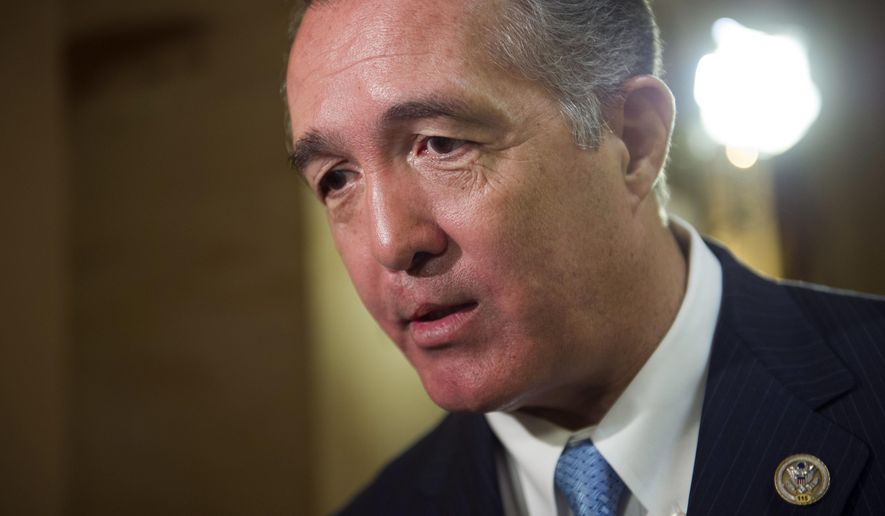 FILE - In this March 24, 2017, file photo, Rep. Trent Franks, R-Ariz. speaks with a reporter on Capitol Hill in Washington. Franks says he is resigning Jan. 31 amid a House Ethics Committee investigation of possible sexual harassment. Franks says in a statement that he never physically intimidated, coerced or attempted to have any sexual contact with any member of his congressional staff. Instead, he says, the dispute resulted from a discussion of surrogacy. Franks and his wife have 3-year-old twins who were conceived through surrogacy. (AP Photo/Cliff Owen, File)