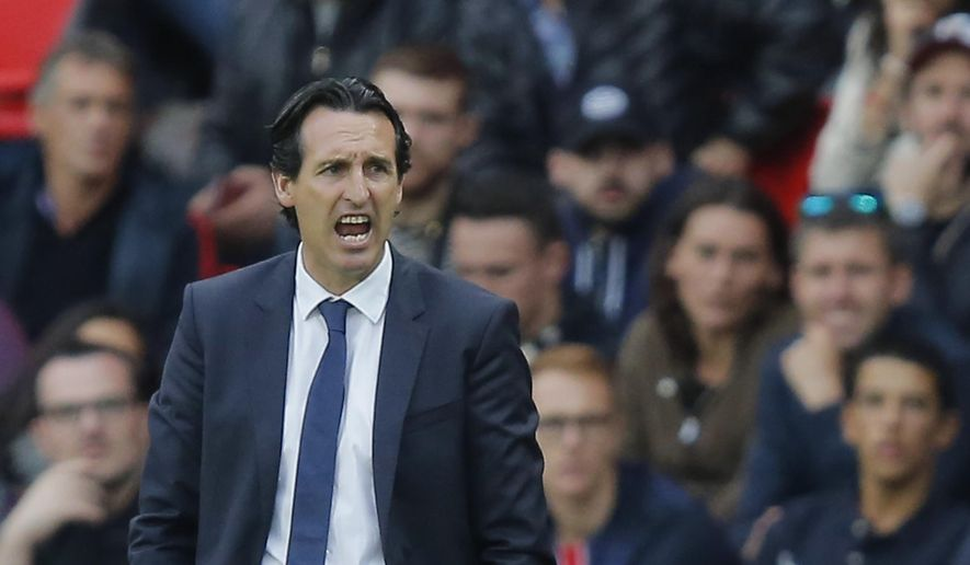 FILE - In this Saturday, Sept. 30, 2017 file photo, PSG's head coach Unai Emery reacts during a French League One soccer match Paris-Saint-Germain against Bordeaux at Parc des Princes stadium in Paris, France. Less than halfway through the season and speculation has already started as to who might replace Unai Emery as Paris Saint-Germain coach. (AP Photo/Michel Euler, File)
