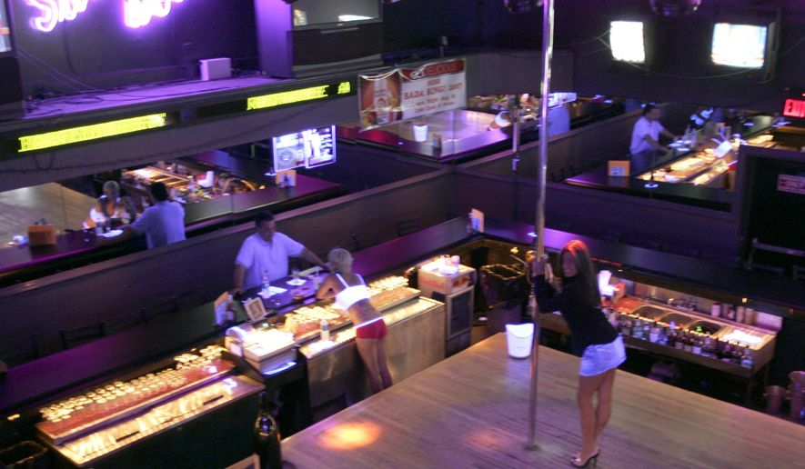 "FILE - This Aug. 17, 2007 file photo shows the interior of the Satin Dolls strip club, which served as the filming location for the Bada Bing strip club scenes for ""The Sopranos,"" series in Lodi, N.J. The club has been ordered to shut down as authorities investigate alleged real-life crimes. New Jersey Attorney General Christopher Porrino announced that Satin Dolls and another club owned by the same family must stop live entertainment this month and sell their liquor licenses by Jan. 3. (AP Photo/Mike Derer, File)"