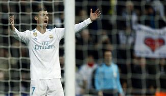 Real Madrid's Cristiano Ronaldo gestures during the Champions League Group H soccer match between Real Madrid and Borussia Dortmund at the Santiago Bernabeu stadium in Madrid, Spain, Wednesday, Dec. 6, 2017. (AP Photo/Francisco Seco)