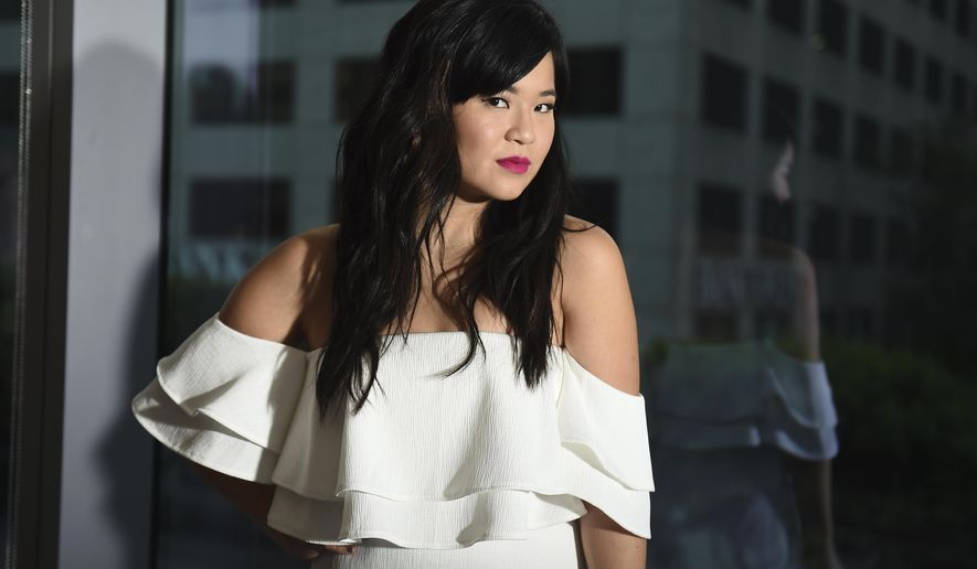 """This Dec. 3, 2017 photo shows actress Kelly Marie Tran posing for a portrait during the """"Star Wars: The Last Jedi"""" press junket in Los Angeles. Tran stars as Rose in the latest installment of the """"Star Wars"""" franchise, in theaters on Dec. 15. (Photo by Jordan Strauss/Invision/AP)"""