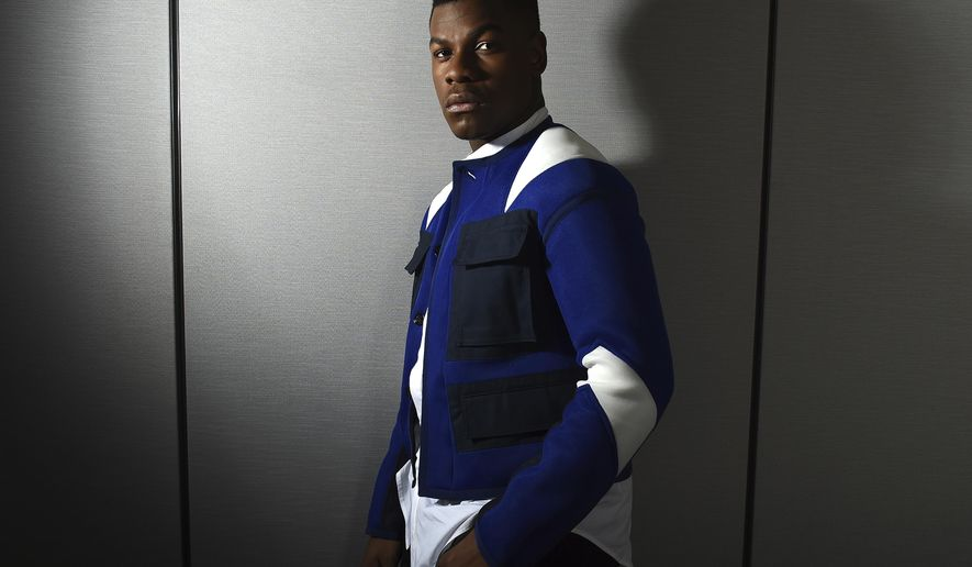 "This Dec. 3, 2017 photo shows John Boyega posing for a portrait during the ""Star Wars: The Last Jedi"" press junket in Los Angeles Boyega stars as Finn in the latest installment of the ""Star Wars"" franchise, in theaters on Dec. 15. (Photo by Jordan Strauss/Invision/AP)"