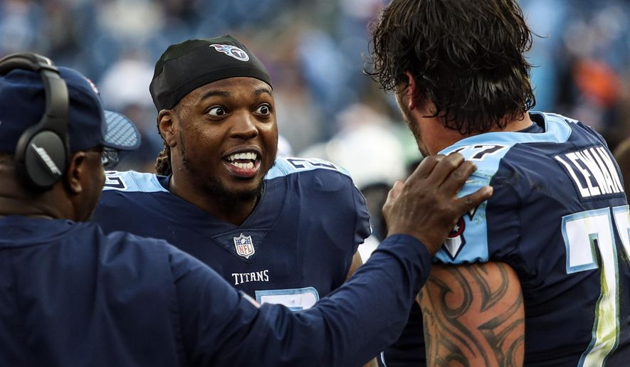 FILE - In this Sunday, Dec. 3, 2017, file photo, Tennessee Titans running back Derrick Henry, center, talks to offensive tackle Taylor Lewan (77) after scoring a touchdown during an NFL football game against the Houston Texans in Nashville, Tenn. Henry says he didn't want to be caught from behind. Well, nobody caught the Tennessee running back as the Heisman Trophy broke loose for a 75-yard run and was clocked at 21.64 mph, tied for the fifth-fastest ball carrier this season.   (Austin Anthony/Daily News via AP, File)