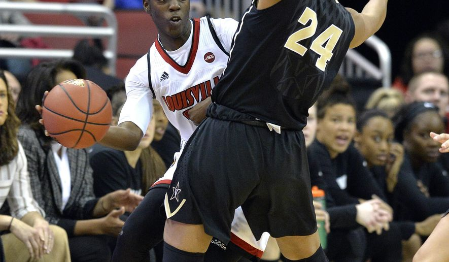 Louisville guard Jazmine Jones, left, passes the ball away from defensive pressure by Vanderbilt forward Autumn Newby (24) during the first half of an NCAA college basketball game, Thursday, Dec. 7, 2017, in Louisville, Ky. (AP Photo/Timothy D. Easley)