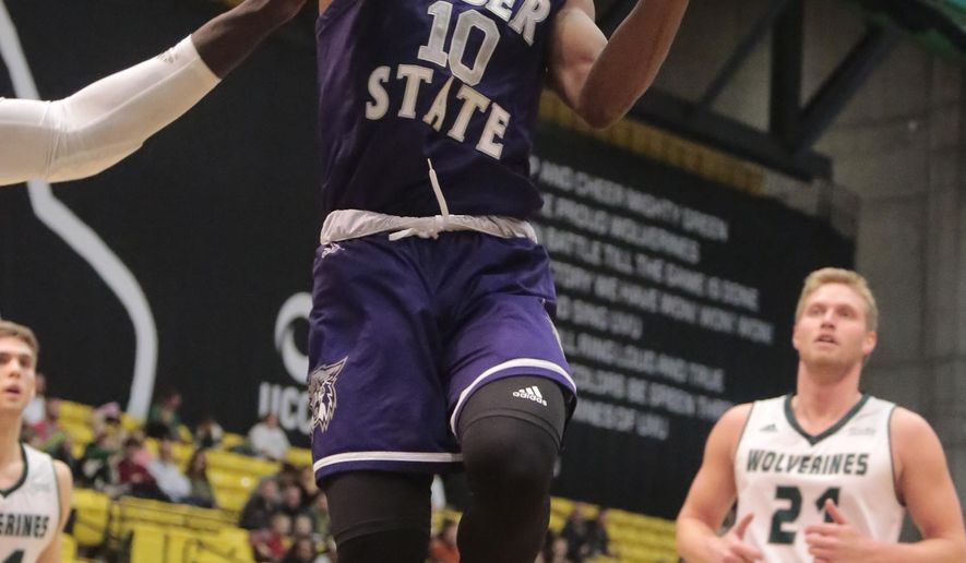 Weber State's Jerrick Harding (10) drives to the basket against Utah Valley during the first half of an NCAA college basketball game Wednesday, Dec. 6, 2017, in Orem, Utah. (Matt Herp/Standard-Examiner via AP)