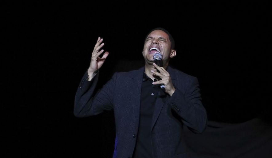 Comedian Trevor Noah performs on stage during the 11th Annual Stand Up for Heroes benefit, presented by the New York Comedy Festival and The Bob Woodruff Foundation, at the Theater at Madison Square Garden on Tuesday, Nov. 7, 2017, in New York. (Photo by Brent N. Clarke/Invision/AP)