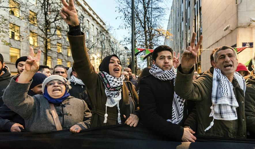 People protest against President Donald Trump's decision to recognize Jerusalem as Israel's capital, near the U.S embassy in Brussels on Friday, Dec. 8, 2017. (AP Photo/Geert Vanden Wijngaert)