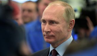 """Russian President Vladimir Putin, announcing his candidacy for another term, said he hoped to """"improve the lives of the people in our country and make our country stronger, safer and forward-looking."""" (Associated Press)"""