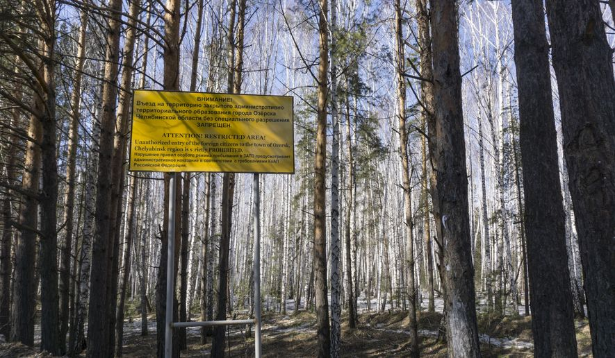In this file photo taken on Friday April 8, 2016, a sign warns people not to enter the town of Ozersk, Chelyabinsk region, Russia, which houses the Mayak nuclear facility. Mayak is a nuclear complex that has been responsible for at least two of the country's biggest radioactive accidents. Russian authorities denied Friday that a radioactivity spike in the air over Europe resulted from a nuclear fuel plant leak in the Urals, saying their probe has found no release of radioactivity there. (AP Photo/Katherine Jacobsen, File)