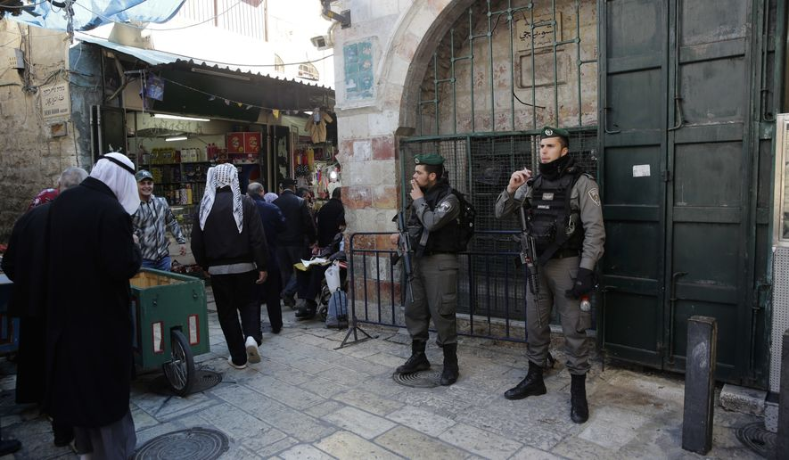 Israeli border policemen stand in Jerusalem's Old City in Jerusalem, Friday, Dec. 8, 2017. Israeli police deployed reinforcements in and around Jerusalem's Old City on Friday, in anticipation of Palestinian protests over the Trump administration's recognition of the contested city as the Israeli capital. (AP Photo/Mahmoud Illean)
