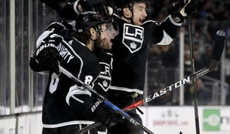 Los Angeles Kings defenseman Drew Doughty, left, celebrates after scoring the game-winning goal during overtime of an NHL hockey game against the Ottawa Senators in Los Angeles, Thursday, Dec. 7, 2017. The Kings won 4-3. (AP Photo/Chris Carlson)