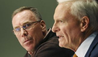 Cleveland Browns owner Jimmy Haslam, right, introduces the NFL football teams new general manager, John Dorsey, left, gestures during an introductory press conference in Berea, Ohio, Friday, Dec. 8, 2017.  (John Kuntz/The Plain Dealer via AP)