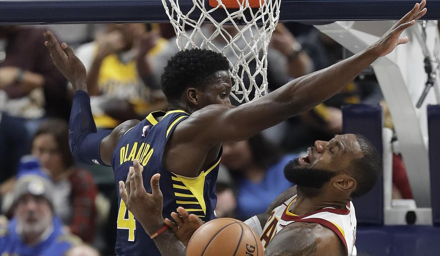 Cleveland Cavaliers' LeBron James is fouled by Indiana Pacers' Victor Oladipo as he goes up for a shot during the second half of an NBA basketball game Friday, Dec. 8, 2017, in Indianapolis. The Pacers won 106-102. (AP Photo/Darron Cummings)