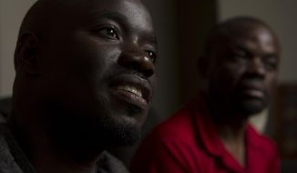 In their native Uganda, a place where being gay can send you to prison, Barnabas Wobiliya, left, and Apollo Kimuli risked their lives as advocates for AIDS education and equality for the LGBTQ community. Threatened with death, both men fled and spent a year in refugee camps before resettlement in Utah. The two are now trying to build their lives here, while using the Internet to continue their activism for others in Africa's LGBTQ community. (Leah Hogsten/The Salt Lake Tribune via AP)