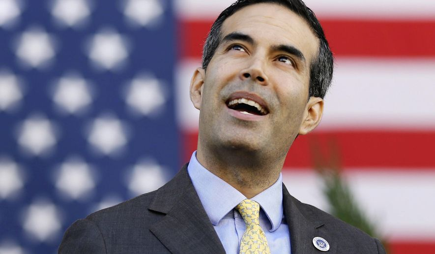FILE - In this Nov. 11, 2016 file photo, Texas Land Commissioner George P. Bush attends a Veterans Day celebration in Dallas. Former Texas Land Commissioner Jerry Patterson is making the unusual move of running again for his old office against Bush, his successor and fellow Republican. Patterson said Friday, Dec. 8, 2017, that he's entering the Republican primary. He ran unsuccessfully for lieutenant governor in 2014 and endorsed Bush for land commissioner that year. (AP Photo/LM Otero, File)