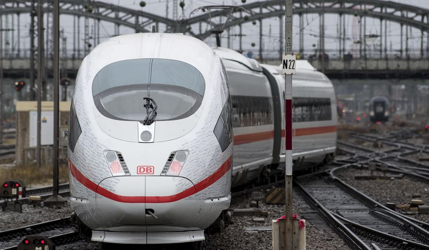 A special train of the Deutsche Bahn (DB) railway company departs towards Berlin at the central station in Munich, Germany, Friday, Dece. 8 2017. The Deutsche Bahn railway company celebrates the opening of the new fast railway track connection between Munich and Berlin on Friday. (Sven Hoppe/dpa via AP)