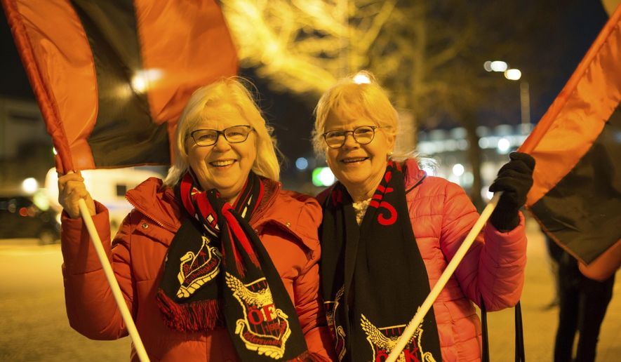 In this photo taken Thursday, Dec. 7, 2017Birgitta Karlsson and her sister Gudrun Alexanderson, Ostersunds FK fans who traveled 23 hours by train and boat to see the Swedish side play Hertha Berlin in the Europa League pose at the Olympiastadion, Berlin, Germany. (AP Photo/Ciaran Fahey)