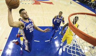 Philadelphia 76ers Ben Simmons, of Australia, goes up for the dunk during the first half of an NBA basketball game against the Los Angeles Lakers, Thursday, Dec. 7, 2017, in Philadelphia. (AP Photo/Chris Szagola)