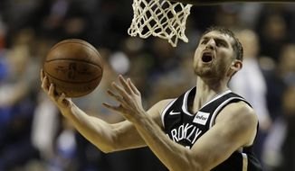 Brooklyn Nets' Tyler Zeller goes to the basket to score in the first half of a regular-season NBA basketball game with Oklahoma City Thunder in Mexico City, Thursday, Dec. 7, 2017. (AP Photo/Rebecca Blackwell)