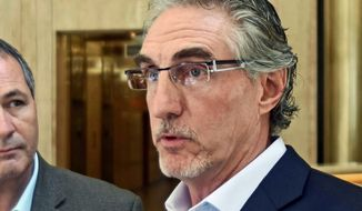 FILE - In this Aug. 22, 2017, file photo, North Dakota Gov. Doug Burgum speaks at a news conference in Bismarck, N.D. Burgum was served with a lawsuit Friday, Dec. 8 that was filed by the North Dakota Legislature challenging his veto powers. The dispute arose when the governor used his line-item veto in April to change parts of several spending bills after the Legislature adjourned. (Tom Stromme/The Bismarck Tribune via AP, File)