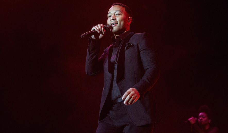 FILE - In this June 30, 2017 file photo, John Legend performs at the 2017 Essence Festival at the Mercedes-Benz Superdome, in New Orleans. Legend will take the stage at the Telenor Arena in Oslo, Norway on Dec. 11 for Nobel Peace Prize Concert, which honors the International Campaign to Abolish Nuclear Weapons. Other performers include Zara Larsson, Sigrid, Matoma and Lukas Graham. (Photo by Amy Harris/Invision/AP, File)