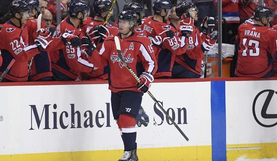 Washington Capitals center Nicklas Backstrom (19), of Sweden, celebrates his goal during the second period of an NHL hockey game against the New York Rangers, Friday, Dec. 8, 2017, in Washington. (AP Photo/Nick Wass)