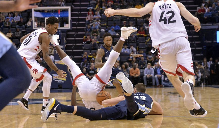 Toronto Raptors forward OG Anunoby, center left, and Memphis Grizzlies center Marc Gasol (33) fall to the court as Raptors guard DeMar DeRozan, from left, Grizzlies guard Ben McLemore, and Raptors center Jakob Poeltl (42) move for the ball in the second half of an NBA basketball game Friday, Dec. 8, 2017, in Memphis, Tenn. (AP Photo/Brandon Dill)