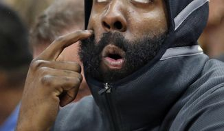 Houston Rockets guard James Harden looks at the scoreboard as he sits on the bench in the first half during an NBA basketball game against the Utah Jazz on Thursday, Dec. 7, 2017, in Salt Lake City. (AP Photo/Rick Bowmer)