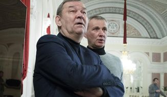 Director of the Bolshoi Theater Vladimir Urin, left, and the ballet director of the Bolshoi Theater Makhar Vaziev, center, attend a meeting with media at the Bolshoi Theater in Moscow, Russia, Friday, Dec. 8, 2017. The Bolshoi Theater first night of the Nureyev ballet staged by Kirill Serebrennikov is scheduled for Saturday, Dec. 9. (AP Photo/Pavel Golovkin)
