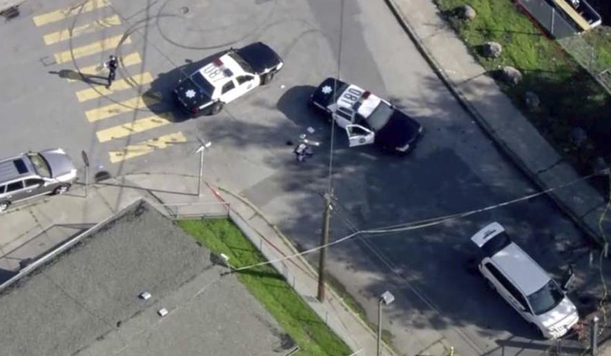 FILE -  In this Dec. 1, 2017 file image provided courtesy of KTVU-TV, San Francisco police investigate an officer-involved shooting in the city's Bayview neighborhood in San Francisco. San Francisco Police Chief Bill Scott has released footage of the fatal police shooting of an unarmed carjacking suspect in the city's Bayview neighborhood. The footage was released at a packed evening town hall meeting Thursday, Dec. 7 where Scott gave the community more information about the shooting. (Courtesy of KTVU-TV via AP, File)
