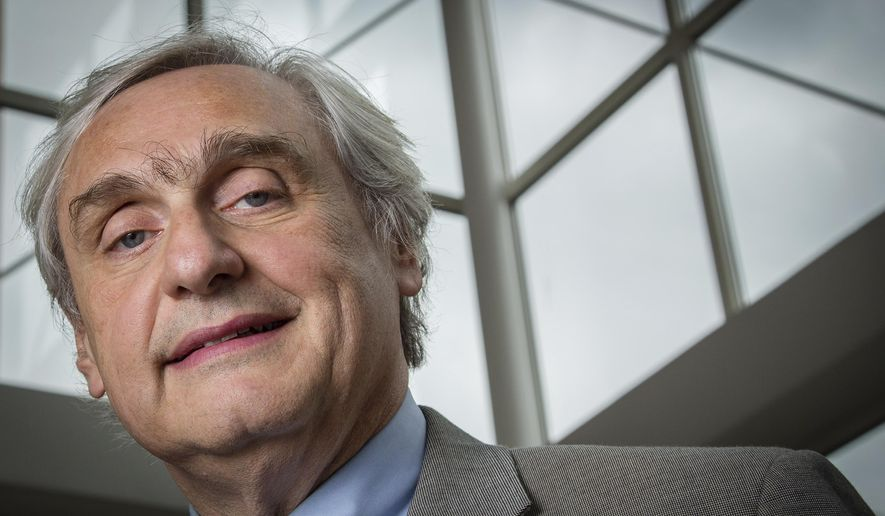 FILE - In this July 24, 2014, file photo, then-Chief Judge of the U.S. Court of Appeals for the Ninth Circuit Alex Kozinski poses for a portrait in the lobby of a Washington office building. Six women who served as clerks or externs at the U.S. 9th Circuit Court of Appeals allege to The Washington Post that judge Alex Kozinski subjected them to inappropriate sexual comments or conduct, including asking them to watch pornography in his chambers, the newspaper reported Friday, Dec. 8, 2017. (AP Photo/J. David Ake, File)